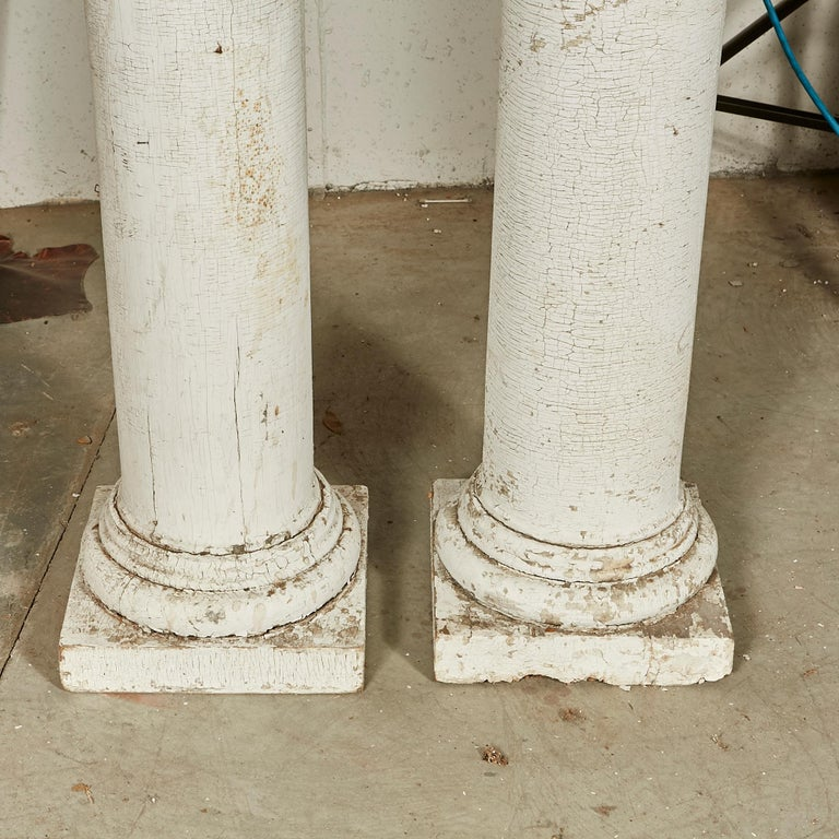 Pair of architectural salvage tall columns with original white paint. A couple of small spots of wrought. In original condition.