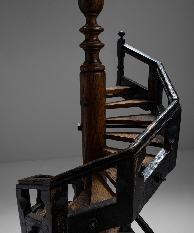 Architectural staircase model  England circa 1890  Oak spiral staircase with ebonised balustrade and a central pillar.