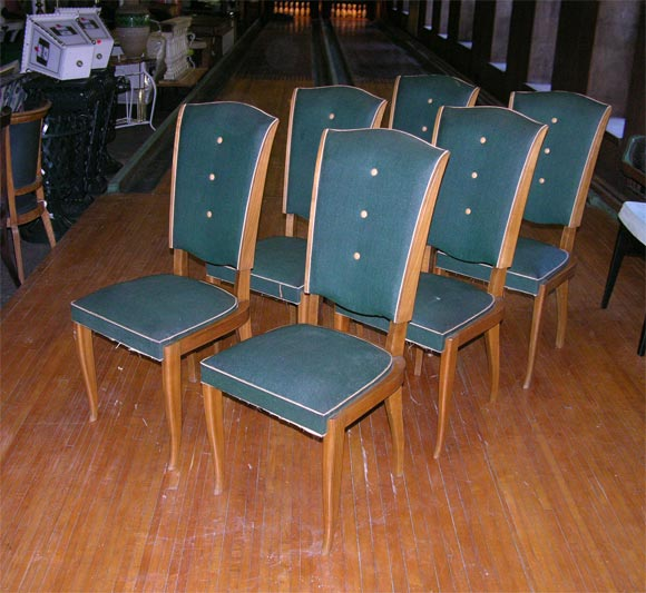 Dark wood frame side chairs with original three button back vinyl upholstery.