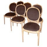 six  Elegant dining chairs with rustic carving.