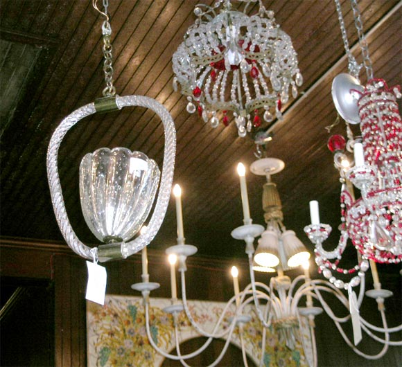 Single vase shaped uplight chandelier.