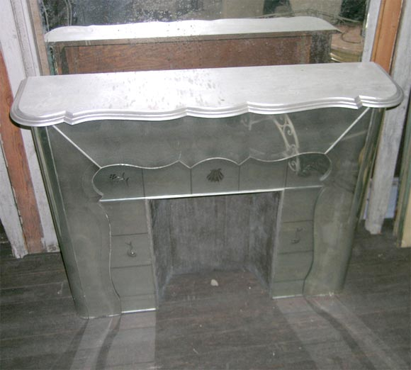 Carved and beveled mantel with shaped and beveled wood top. Carved shell and sea decorations. Front vertical pieces are 12