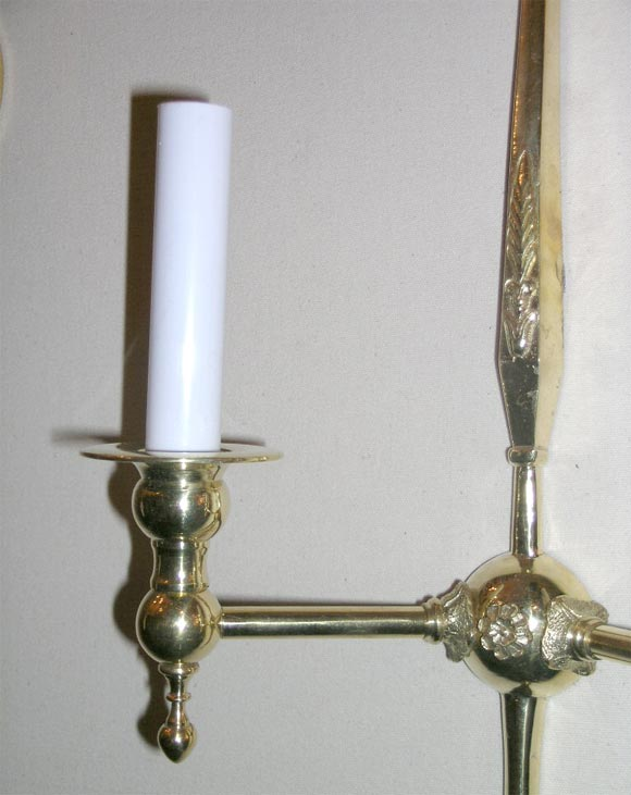 pair of long brass wired sconces with feather inscription at 1stdibs