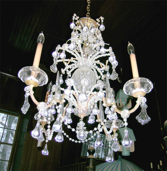 Fine quality four-arm beaded French crystal chandelier.
