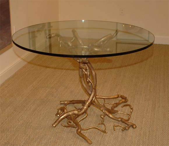 Beautiful hand-forged branch table in gold leaf finish with beveled glass top. Other finishes are available. 