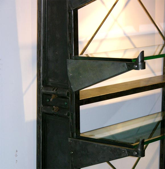 20th Century Polished Steel Industrial shelving unit w/glass shelving For Sale