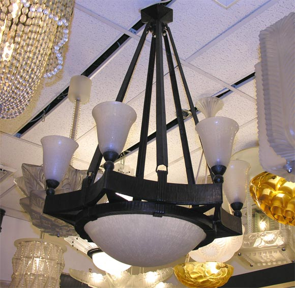 Wrought iron chandelier by Brandt, frosted glass shades by Daum, signed.