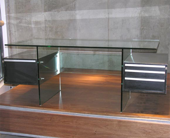 1970s aluminum and glass desk designed by Xavier Marbot. The editor is MD.