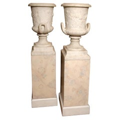 Pair of White Granite Urns on Faux Marble Pedestals