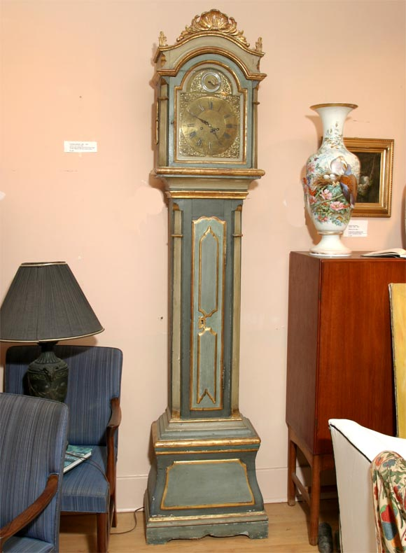 Handsome painted long case clock from South Jutland in Denmark with brass face and small bird detail depicting second hand. Painted in pale grey-green and gold and gilded. Strikes on the hour and half-hour, runs 8 days. In good working condition.
