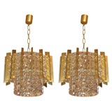 Two Circular Chandeliers in Glass Bronze and Brass