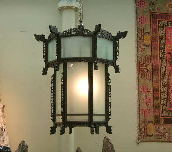 Large six-sided lantern with frosted glass panels, finely carved details, and twisted dragon motif.