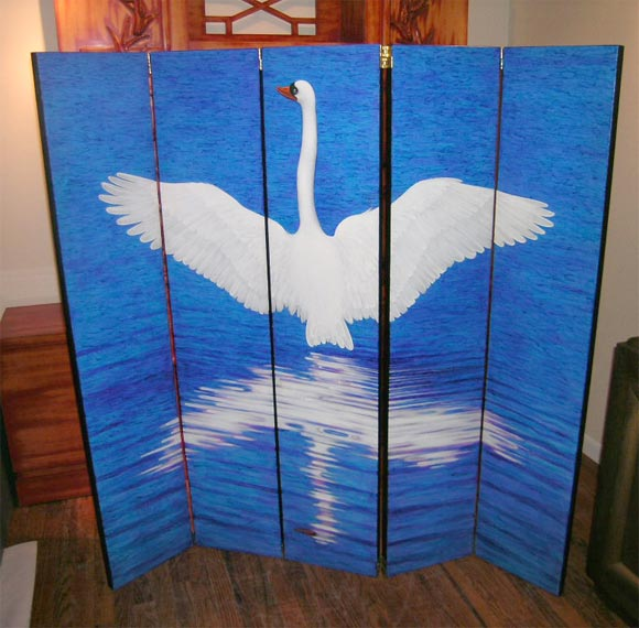Five-panel folding screen hand-painted with a swan and its reflection by Lynn Curlee, fine artist and author/illustrator of award winning books for children, The reverse is painted a dark mottled green. Edges are black. The hinges are reversible