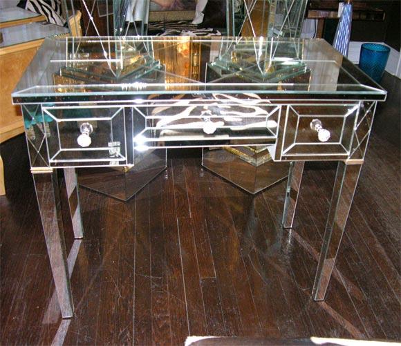 Custom mirrored writing desk.