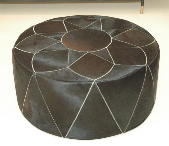Gorgeous dark, dark chocolate cowhide pouf made by Grand Splendid with elaborate stitched star pattern.  Available in custom hide colors and also in one smaller 26' diam. size or 42