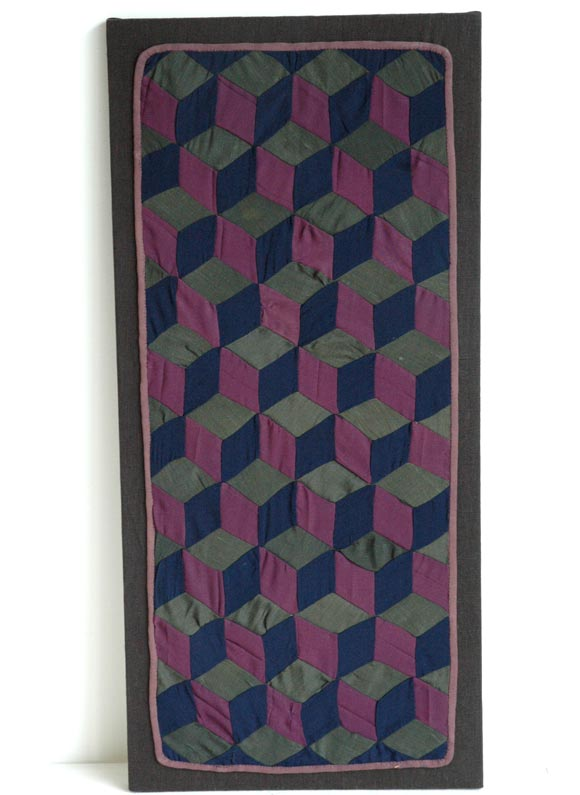 The tumbling blocks Amish quilt, all wool, great piecing and wonderful colors. This cradle quilt is very rare.