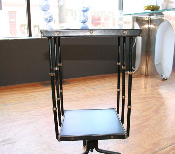 Revolving book stand library table by jacques adnet at for Revolving end table