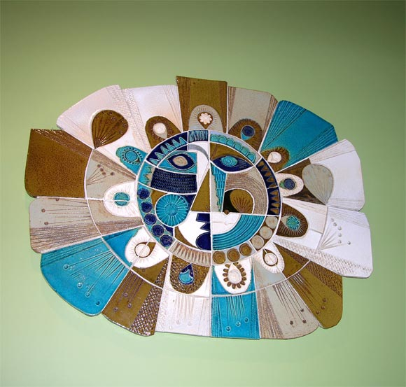 A rare prototype, this beautiful wall sculpture was based on collaborative work Capron had done a couple of years earlier with the artist Jean Derval for the Hotel Byblos, St. Tropez. The coloring is sea blue, moss, white and taupe.