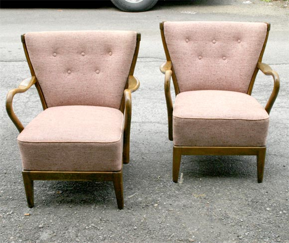 Comfortable pair of upholstered armchairs, with buttoned backs,  mahogany frames.<br />