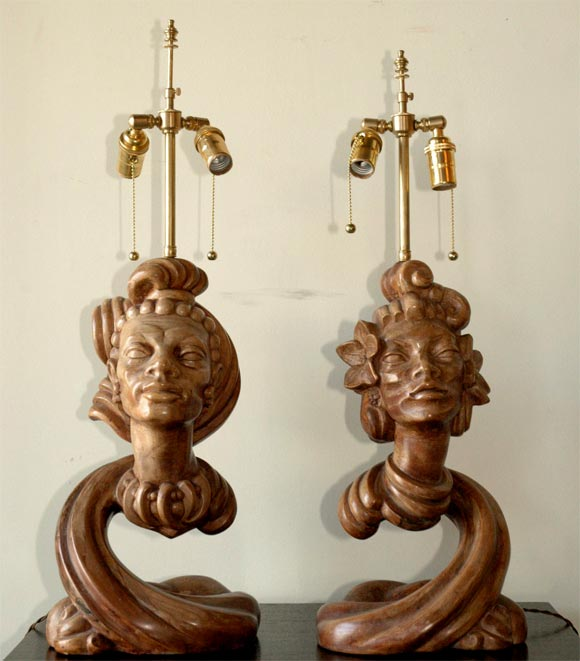 Pair of male and female tropical Pacific or Caribbean Isle influenced lamps. Heavy cast plaster; very well executed with great detail. Painted finish resembles faux bois. Signed Luigi. Almost no wear. Rewired with double clusters.