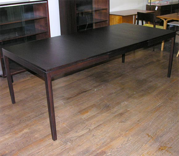 this florence knoll dark stained teak dining table with large leaf is