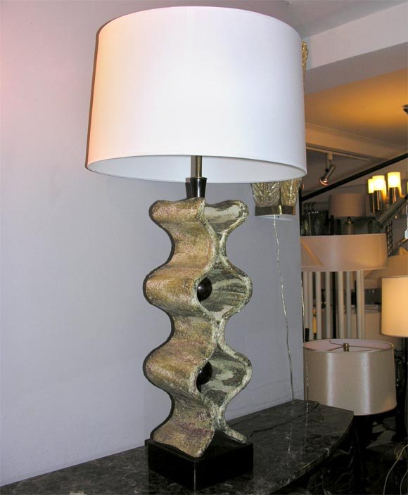 A 1950s Italian sculptural table lamp. Shade not included