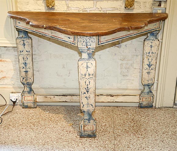 An early 20th century console table painted in the Portuguese style with natural wood top.