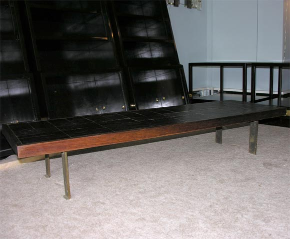 Pierre Lebe' elegant coffee table, made of mahogany with a slate tile top, it rests on slender bronze legs.