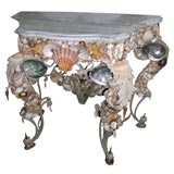 shell encrusted wrought iron marble top console table