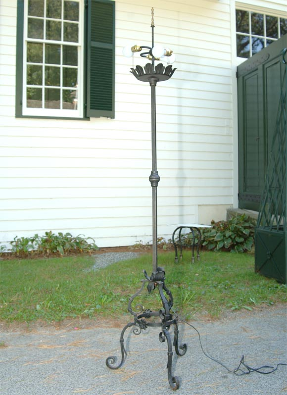 Handwrought iron floor lamps with three bulb fittings, newly rewired.