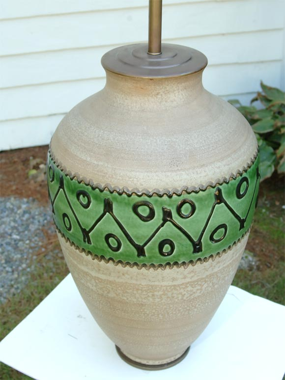 Natural pottery with a glazed decorative band.