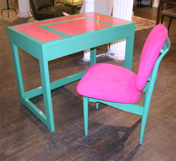 Vibrant & beautifully detailed table of green lacquer & inset pink leather with greek-key embossing.   This playful desk has a single drawer & a lift-up mirror.  Accompanied by a matching lacquered chair, upholstered in pink ultrasuede. This is a