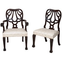 Set of 12 Carved Mahogany Dining Chairs, after Giles Grendey