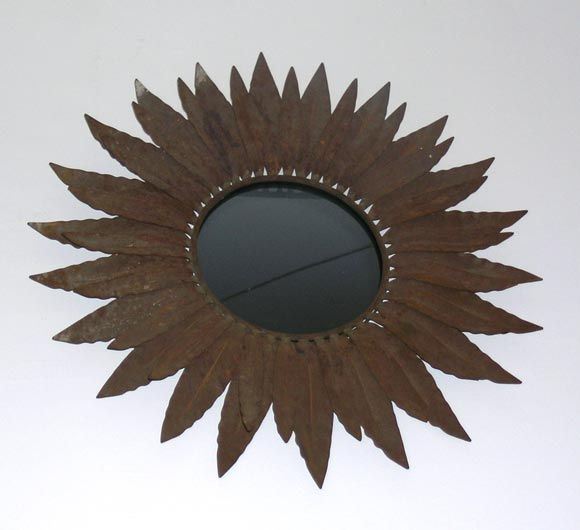 Two wrought iron sunburst / star / starburst wall mirrors in the form of interlaced palm fronds. Sold individually or as a pair.