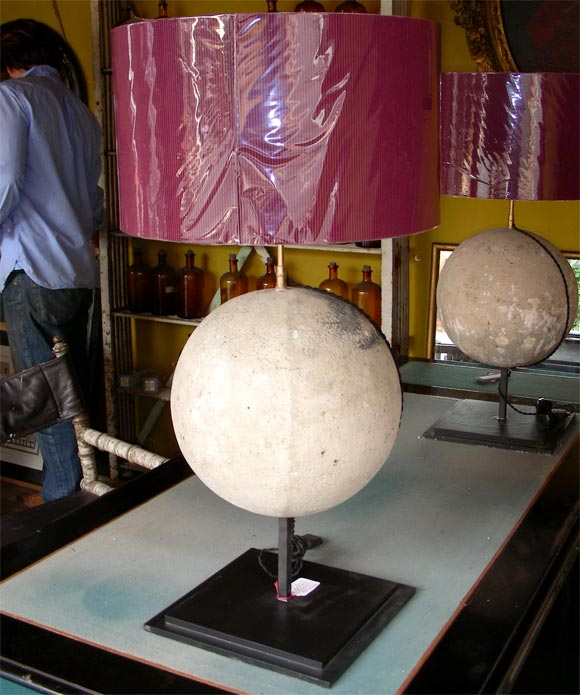 Two lamps with a solid stone sphere set in the stem. Metal base. New shades and new electric wiring.