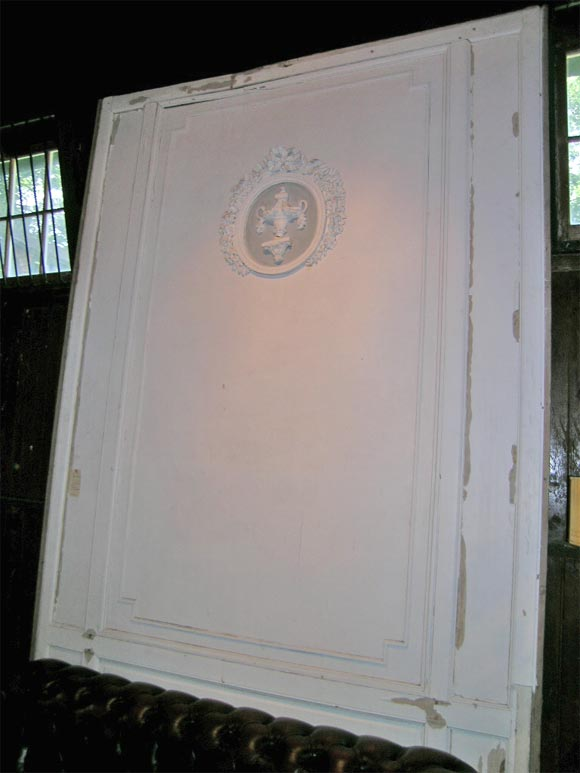 Large painted curved boisere panel. Consisting of rectilinear mouldings and a circular medallion.