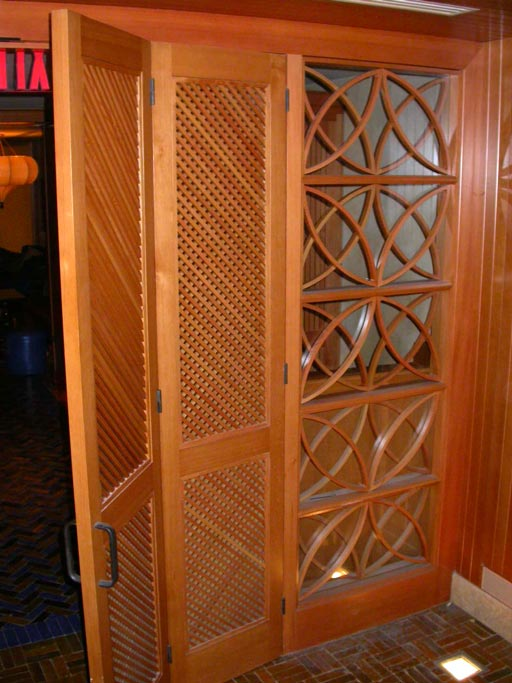 Beautifully Detailed Bi Fold Doors W Decorative Gled Panels Are In A