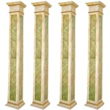 * 20122 Set of four Italian faux marbre and gilded wood columns