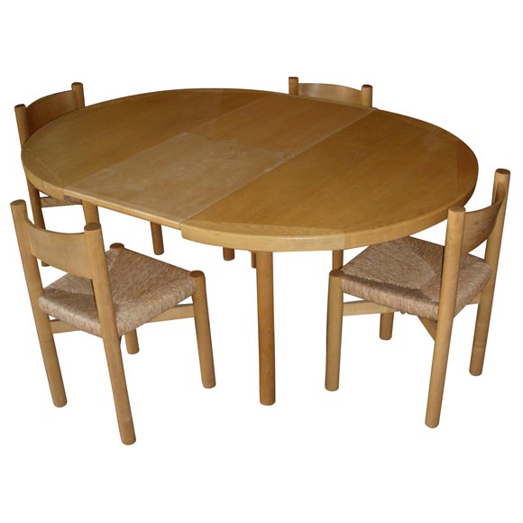 round beech table and four chairs by charlotte perriand at