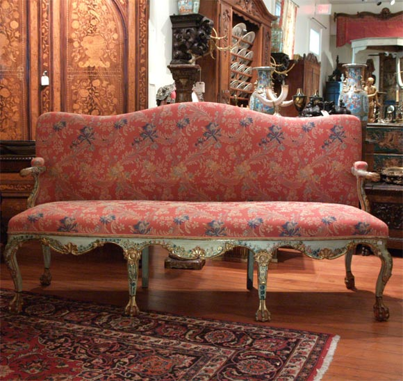 Excellent Painted Venetian Sofa with floral decoration and parcel gilt. Wonderful movement in arms and front rail.