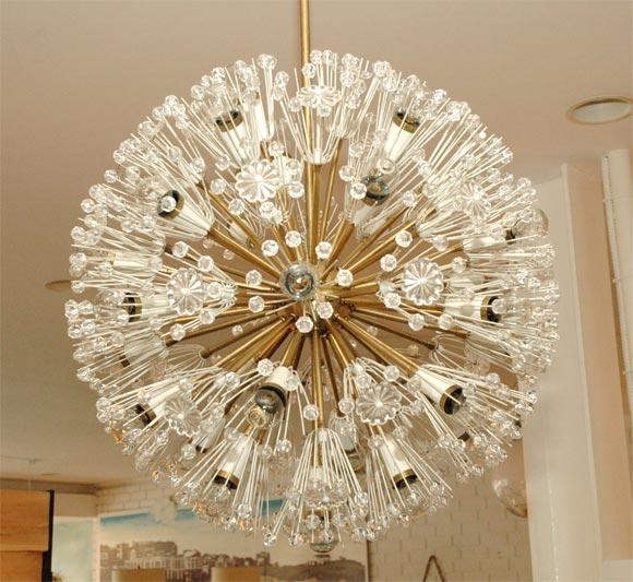 Large scale Austrian sputnik chandelier by Emil Stejnar. Dozens of plexiglass balls and flowers stem from brass center. Professionally rewired.