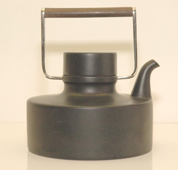 Produced by Rosenthal from 1963 until 1975 in black porcelain, with a silver-plated brass and teak handle, this exquisite teapot is unmistakably the product of multidisciplinary master Tapio Wirkkala.
