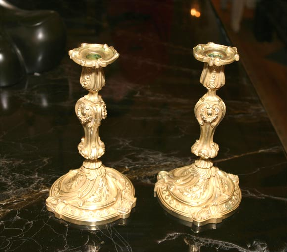 A pair of finely cast and chased Louis XV bronze candlesticks.