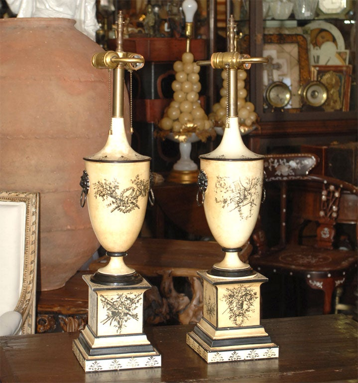 Classical 18th century style painted tin urn-shaped lamps. The height below is to the top of the finial.  The depth is of the base.