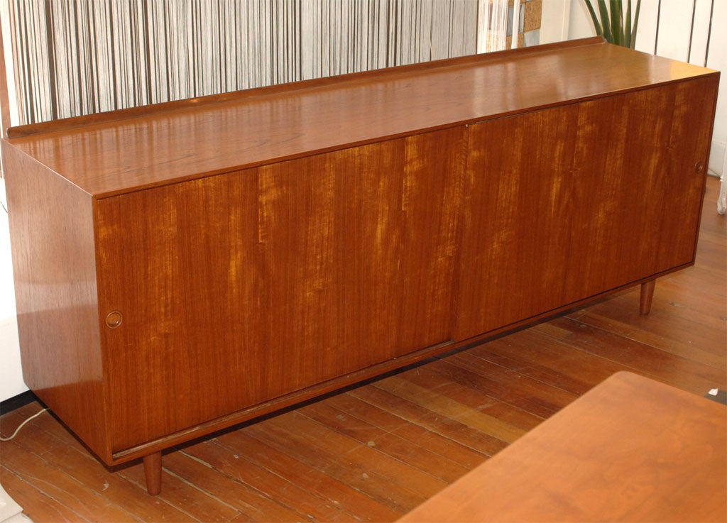 Elegant Finn Juhl design buffet for Baker furniture co. Danish modern style made from solid teak with high quality construction and attention to detail. Completely restored. Originally $6800.00 Net price $4800.00