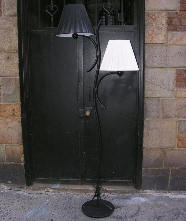 A pair of French art moderne floor lamps. Shades not included