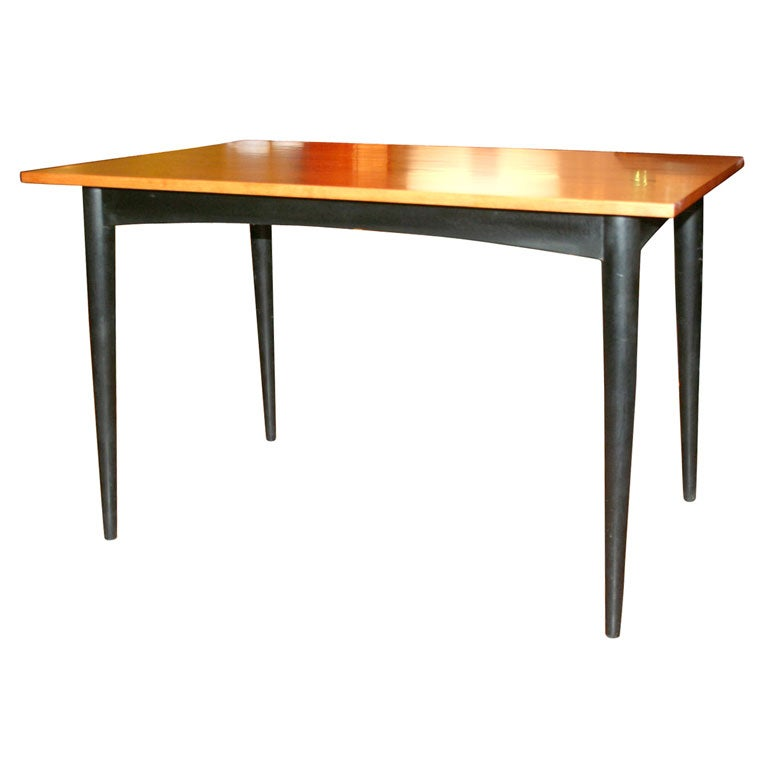 Dining Room Table With Tapered Legs In The Style Of Paul