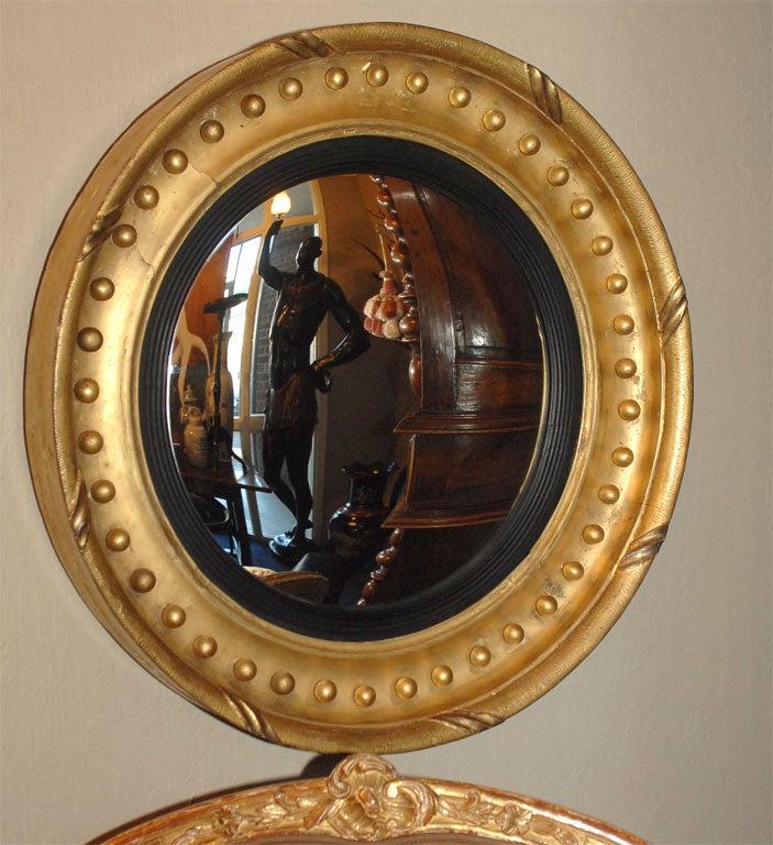 Regency Parcel Ebonized Giltwood Bullseye Mirror At 1stdibs