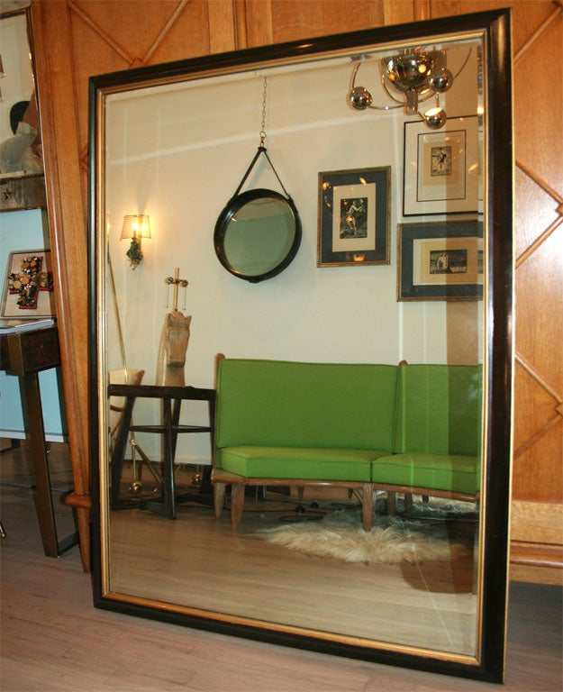 Fantastic and large mirror, all Mahogany construction with gilt accents. Price for one.