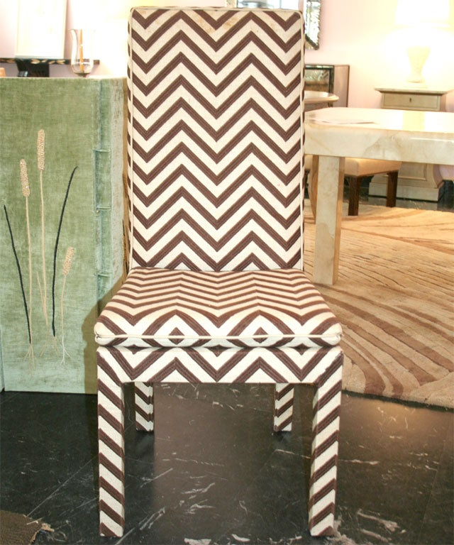 Set of four custom-made side chairs upholstered in a brown and beige chevron pattern raffia.